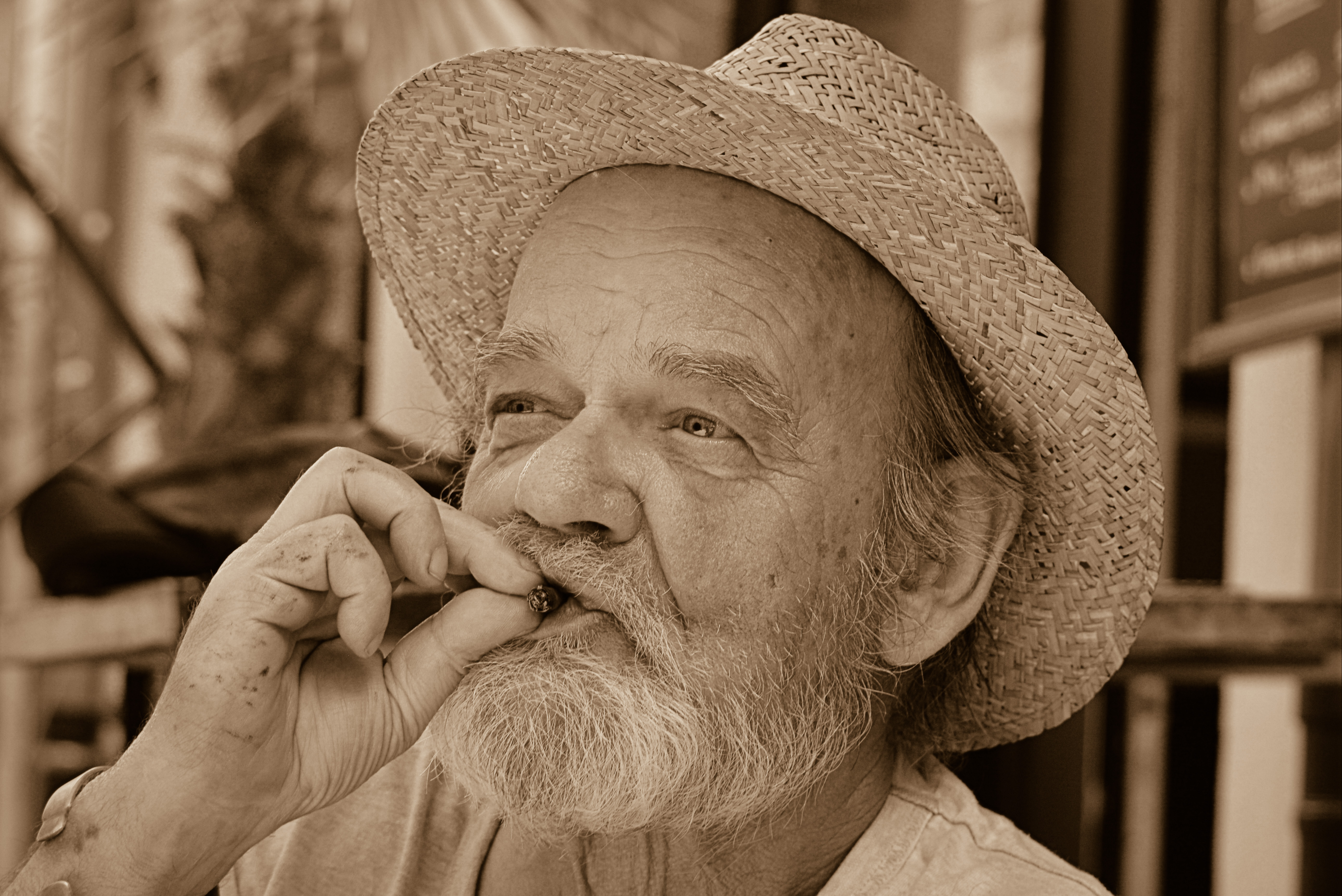Senior gentleman smoking a marijuana joint.