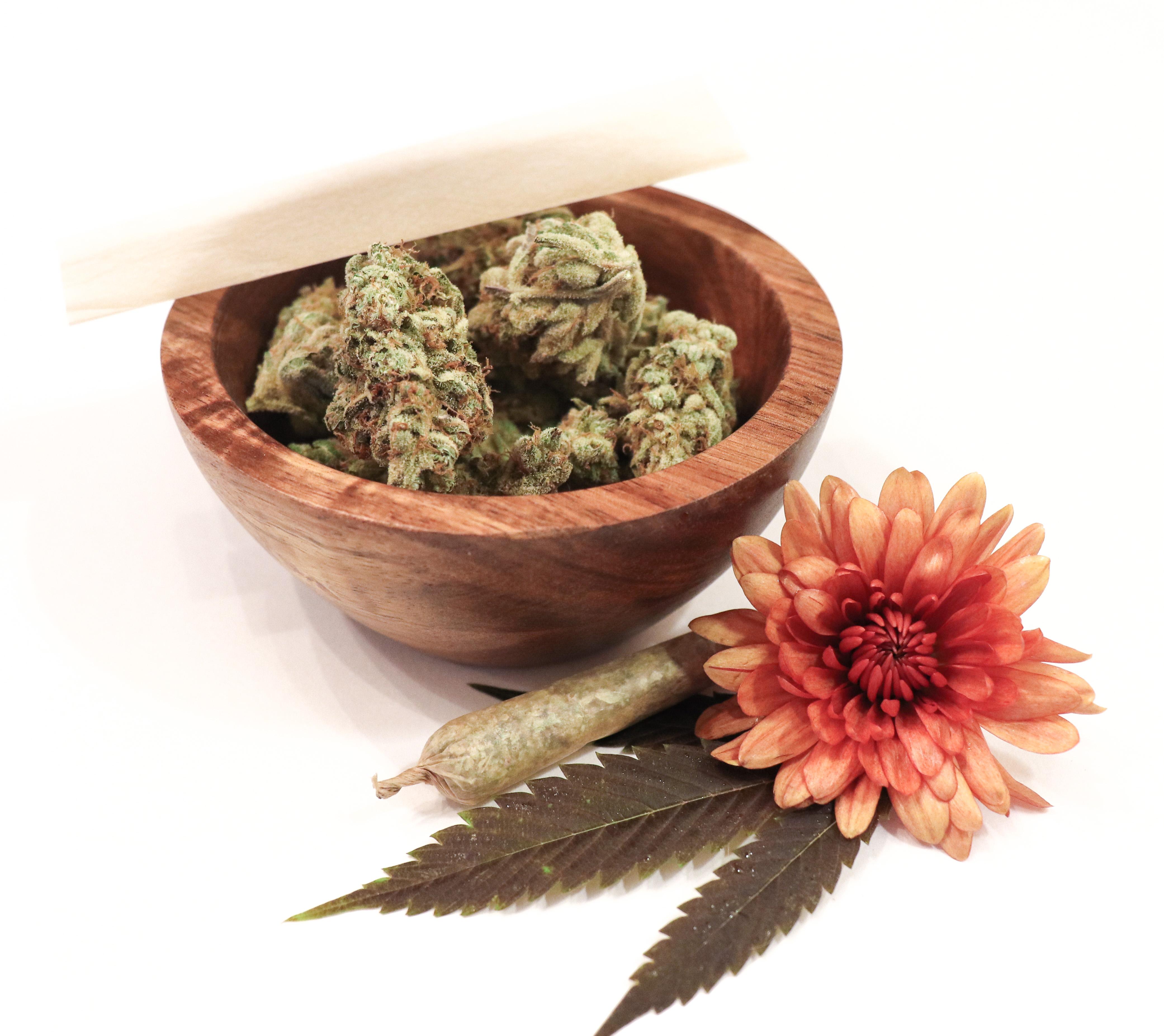 Marijuana flower buds in a bowl.