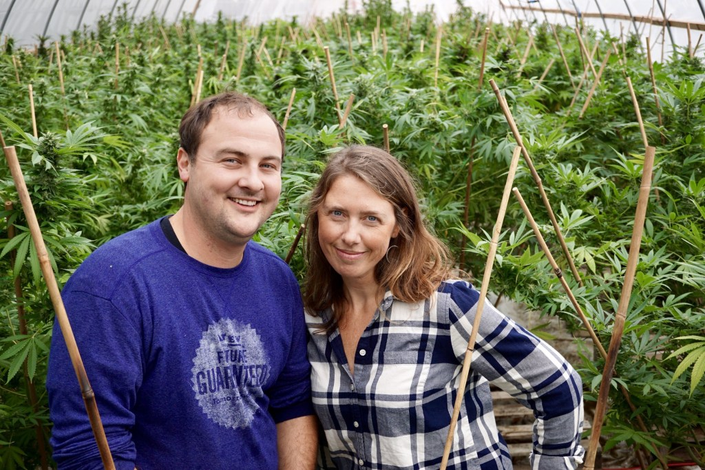 Sweet Dirt founders, Hughes and Kristin Pope, in an early Sweet Dirt greenhouse.